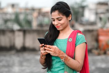 Pretty,Young,Indian,Woman,Using,Her,Phone.